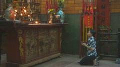 Pilgrim do praying with burning incense sticks at Quang Duc Pagoda temple, Can T Stock Footage