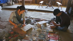 Young woman and man produces wood souvenirs, SaPa, Vietnam Stock Footage