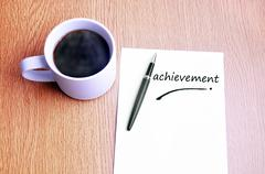 Coffee, pen and notes write achievement - stock photo