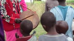 Drum and singing, children and women, Kenya, Samburu tribe, Africa Stock Footage