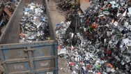Stock Video Footage of processing waste electrical and electronic goods at scrapyard