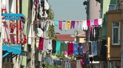 Laundry hanging on the narrow streets of Balat,Istanbul Stock Footage