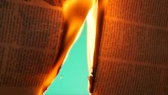 Burning newspaper opening another view chroma key  Stock Footage