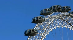 Moving London Eye on blue sky background. Time lapse Stock Footage