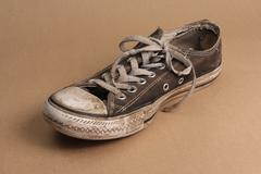 Shoe in really bad condition - stock photo