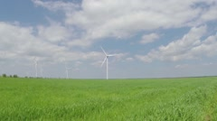 Green field with working wind turbines Stock Footage