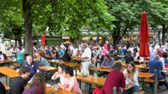 Unidentified people at the famous Viktualienmarkt in Munich, Germany Stock Footage