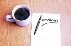 Coffee, pen and notes write excellence Stock Photos