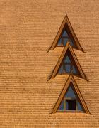Windows on a wood shingle roof Stock Photos