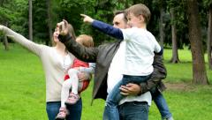 family (couple in love, girl and boy) take a photo with smartphone-monuments - stock footage