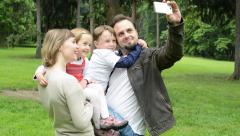 family (couple in love, girl and boy) take a photo with smartphone(selfie) - stock footage
