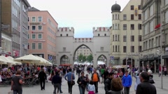 People walking through the famous Karlstor in Munich, Germany Stock Footage