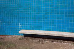 Blue Tiles Wall with Bench - stock photo