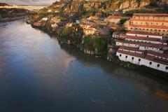 Sunset at Vila Nova de Gaia by Douro River in Portugal Stock Photos