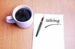 Coffee, pen and notes write solving - stock photo