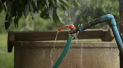 Water leaking from faucet in the garden,Thailand. Stock Footage