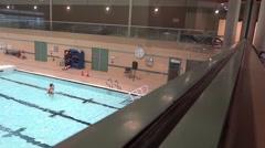 Public Swimming Pool - 10 - Water, Senior Woman, Clock, Balcony Stock Footage