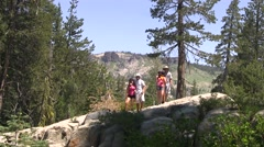 Teen hikers posing for a picture - stock footage