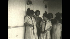 Vintage 16mm film, 1927, SS Manchuria young girls standing Stock Footage