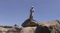Teen hiker looks like a founding father Stock Footage
