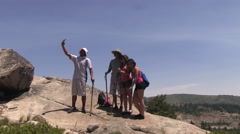 Teen hikers stop to take a selfie Stock Footage