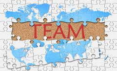 Jigsaw puzzle reveal  word team Stock Illustration