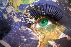 Womans face with planet Earth texture and turkmenistan flag inside the eye. Stock Photos