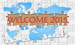 Jigsaw puzzle reveal  word welcome 2015 - stock illustration
