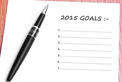 Pen  and notes paper with 2015 goals list Stock Photos