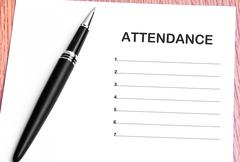Pen  and notes paper with attendance list - stock photo