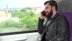 Young handsome hipster man travel by train and phone with smartphone - city Stock Footage