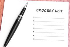 Pen  and notes paper with grocery list Stock Photos