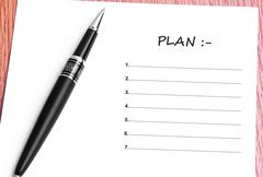 Pen  and notes paper with plan list - stock photo