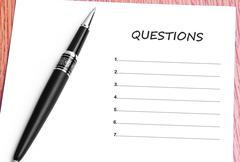 Pen  and notes paper with questions list Stock Photos