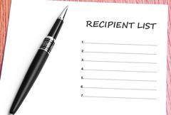Pen  and notes paper with recipient list - stock photo