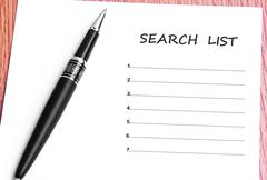 Pen  and notes paper with search list Stock Photos