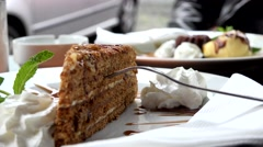 Food - desserts - honey cake and sand cake in background - detail Stock Footage
