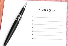 Pen  and notes paper with skills list Stock Photos