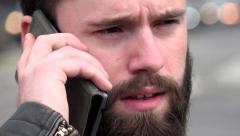Young handsome hipster man phone with smartphone - city - urban street - closeup Stock Footage