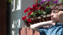 Young man, sunbathing, home garden, sunny day, summer Stock Footage