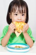 Little Asain Chinese Eating Pizza - stock photo