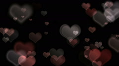 Hearts flying on luminous background Stock Footage