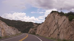 Stock Video Footage of Driving Down a Curvy Road in the Mountains