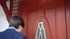 Door-to-door salesman, young man, elegant suit, knock, front door, business Stock Footage