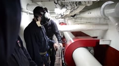 Sailors on USS Essex conduct a chemical, biological, and radiological drill Stock Footage