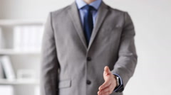 Close up of businessman giving hand for handshake Stock Footage