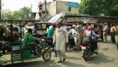 Indian traffic. Pedestrians, rickshaws, motorcycles moving erratically. - stock footage
