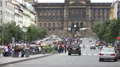 Wenceslas Square with people and passing cars - buildings and nature Stock Footage