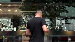 city - watch store (shop window) - urban street - walking people - stock footage
