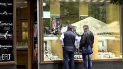 city - jewelry store (shop window) - urban street - walking people - stock footage